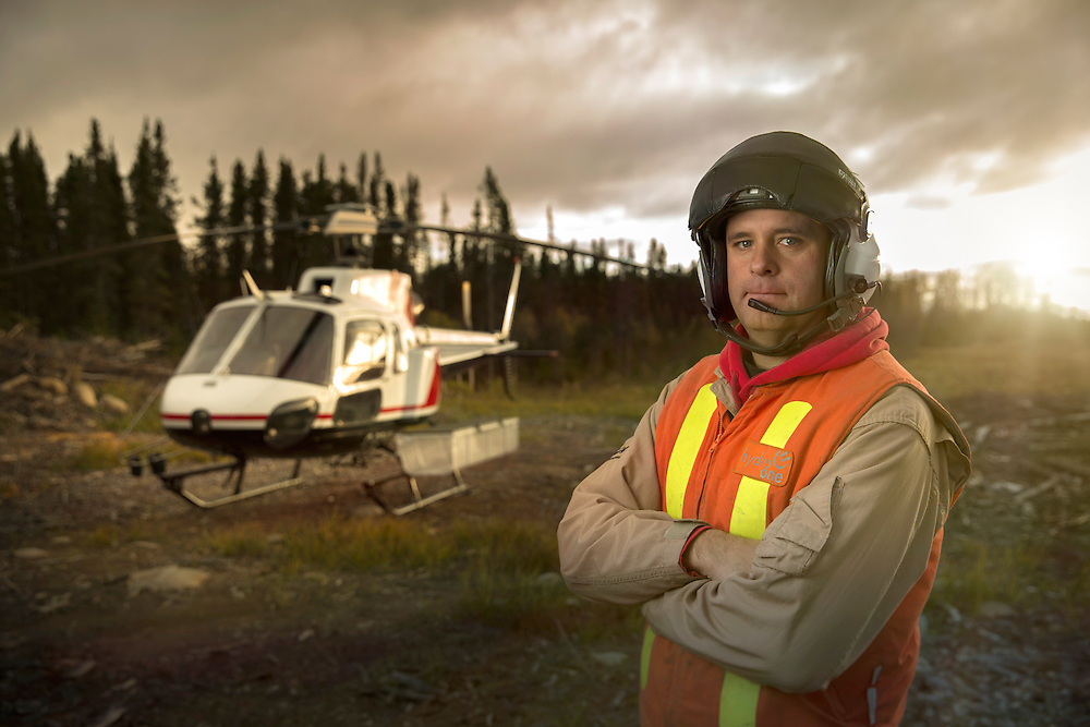 Helicopter Pilot in Thunder Bay Ontario landed in abandoned field for Hydro One Workers Shot as a Environmental Portrait on a Canon 5D Mark III