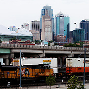 Freight train traffic passing in front of the Downtown Kansas City skyline.