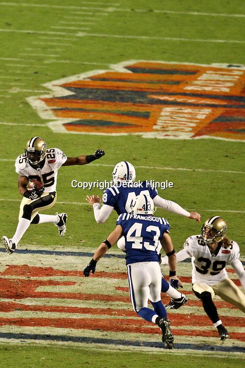 2010 February 07: New Orleans Saints running back Reggie Bush (25) returns a punt against the Indianapolis Colts during a 31-17 win by the New Orleans Saints over the Indianapolis Colts in Super Bowl XLIV at Sun Life Stadium in Miami, Florida.