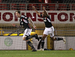 Bristol City's Aden Flint celebrates celebrates scoring his sides third goal chased by Tyrone Barnett - Photo mandatory by-line: Robin White/JMP - Tel: Mobile: 07966 386802 11/02/2014 - SPORT - FOOTBALL - Leyton - Brisbane Road - Leyton Orient v Bristol City - Sky Bet League One
