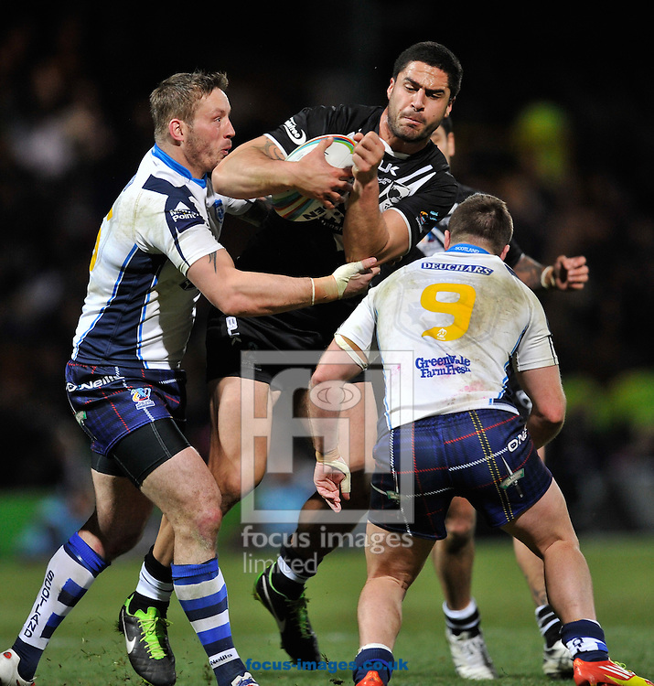 Picture by Richard Land/Focus Images Ltd +44 7713 507003<br /> 15/11/2013<br /> Jesse Bromwich of New Zealand is stopped by Oliver Wilkes (L) &amp; Ian Henderson (9) of Scotland during the Rugby League World Cup 2013 quarter final at Headingley Carnegie Stadium, Leeds.