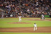 San Francisco Giants' pitcher Matt Cain (18) pitches to Cardinals' outfielder Allen Craig (21) during the NLCS Game 7 between the San Francisco Giants and the St. Louis Cardinals on Oct. 22, 2012 in San Francisco, Calif.  Cain allowed five hits during 5.2 innings to help the Giants win 9-0.  Photo by Stan Olszewski/SOSKIphoto.