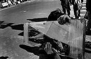 """A woman carries panes of glass through Chinatown...Part of long-term (2005-2008) story """"I See A Darkness"""". New York, NY."""