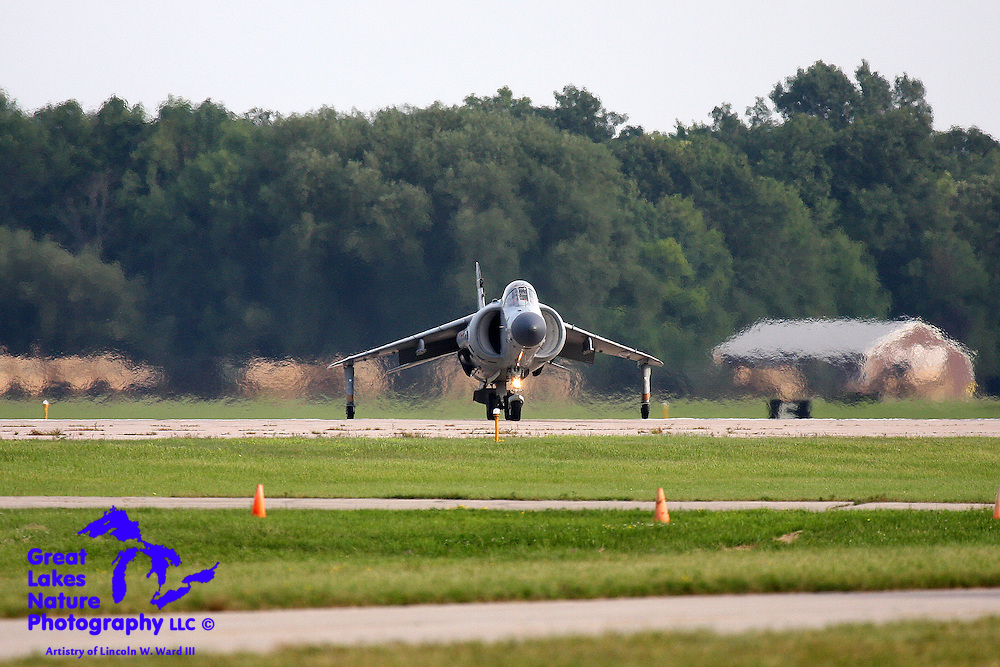 A BAE Sea Harrier F/A2 lands vertically at Whitman Regional Airport in Oshkosh, Wisconsin. Its owner is retired Marine test pilot Lt. Col. Art Nalls. This is the only privately owned Harrier jump jet in the world.