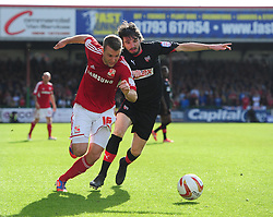 Swindon Town's Andy Williams battles for the ball with Brentford's Jonathan Douglas - Photo mandatory by-line: Joe Meredith/JMP - Tel: Mobile: 07966 386802 04/05/2013 - SPORT - FOOTBALL - County Ground - Swindon - Swindon Town v Brentford - Npower League one Play Off