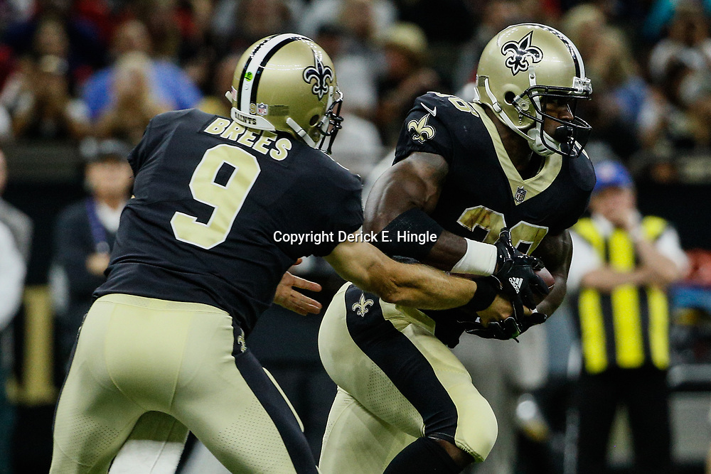 Aug 26, 2017; New Orleans, LA, USA; New Orleans Saints quarterback Drew Brees (9) hands off to running back Adrian Peterson (28) during the second quarter of a preseason game against the Houston Texans at the Mercedes-Benz Superdome. Mandatory Credit: Derick E. Hingle-USA TODAY Sports