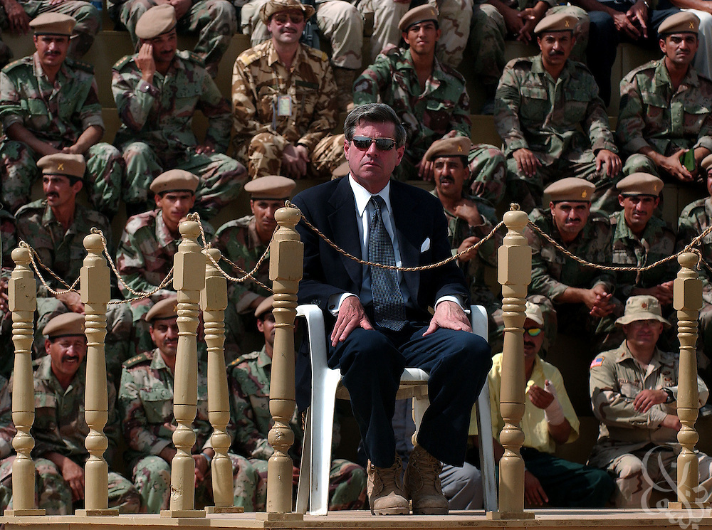 Coalition Provisional Authority Administrator L. Paul Bremer reviews the first battalion of New Iraqi Army (NIA) soldiers during their October 4, 2003 graduation ceremony at the Iraqi Army training center in Kirkush, Iraq.