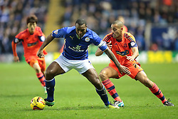 Leicester City's Wes Morgan holds off Bolton Wanderers' Darren Pratley - Photo mandatory by-line: Nigel Pitts-Drake/JMP - Tel: Mobile: 07966 386802 29/12/2013 - SPORT - FOOTBALL - King Power Stadium - Leicester - Leicester City v Bolton Wanderers - Sky Bet Championship