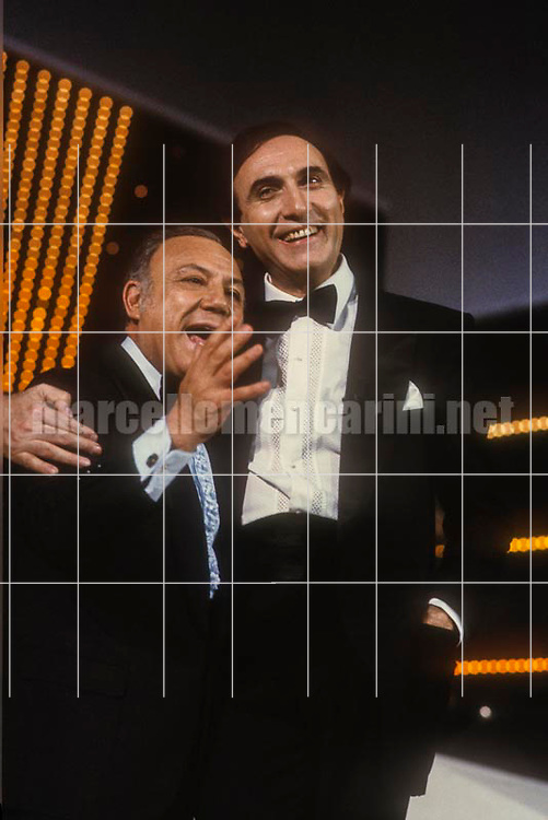 Sanremo Music festival 1984. Italian singer Claudio Villa, special guest of the Festival, and TV presenter Pippo Baudo / Festival di Sanremo 1984. Il cantante Claudio Villa, ospite del festival, e il presentatore televisivo Pippo Baudo - © Marcello Mencarini