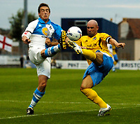 Photo: Richard Lane.<br />Bristol Rovers v Wycombe Wanderers. Coca Cola League 2. 08/08/2006. <br />Wycombe's Tommy Mooney (rt) crosses as Rover's Craig Hinton challenges.