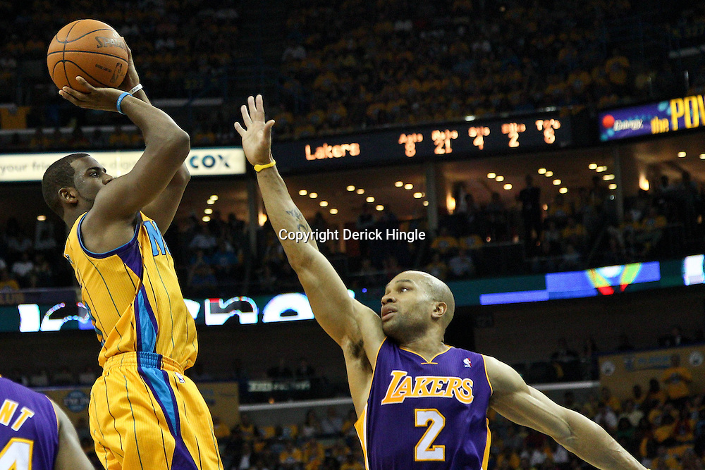 April 22, 2011; New Orleans, LA, USA; New Orleans Hornets point guard Chris Paul (3) shoots over Los Angeles Lakers point guard Derek Fisher (2) during the second quarter in game three of the first round of the 2011 NBA playoffs at the New Orleans Arena.    Mandatory Credit: Derick E. Hingle