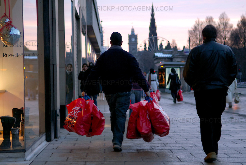 EDINBURGH, UK - 26th December 2010: Shoppers looking for a Boxing Day bargain hit the streets early this morning in Edinburgh. ..Picture shows a man carrying bags after shopping on Boxing day in Princes Street, Edinburgh...(Photograph: Richard Scott/MAVERICK)