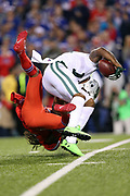 New York Jets wide receiver Brandon Marshall (15) gets tackled awkwardly by Buffalo Bills cornerback Stephon Gilmore (24) as he catches a pass plus a face mask penalty for a gain of 18 yards and a first down to the Buffalo Bills 4 yard line in the second quarter during the 2016 NFL week 2 regular season football game against the against the Buffalo Bills on Thursday, Sept. 15, 2016 in Orchard Park, N.Y. The Jets won the game 37-31. (©Paul Anthony Spinelli)