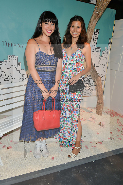 Left to right, MELISSA HEMSLEY and JASMINE HEMSLEY at the Tiffany & Co. Exhibition 'Fifth And 57th' Opening Night held in The Old Selfridges Hotel, Orchard Street, London on 1st July 2015.