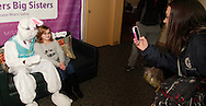 Emily Lizak of Fairborn (right) takes a picture of her little sister Brooklyn, 10 of Dayton with the Easter Bunny at the Big Brothers Big Sisters of the Greater Miami Valley office in Moraine, Saturday, March 23, 2013.