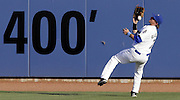 Driller center fielder Charlie Blackmon bobbles the fly catch against the Travelers in Tulsa, OK.