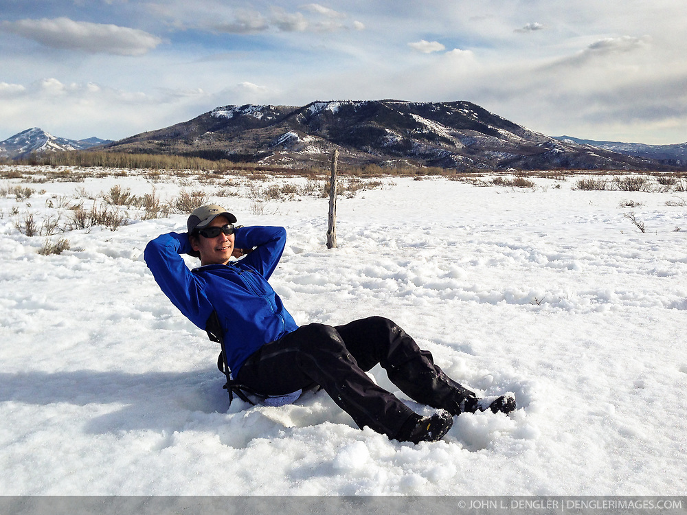 Wildlife photojournalist Noppadol Paothong relaxes after having spent the early morning hours photographing grouse in Wyoming. ©John L. Dengler / DenglerImages.com