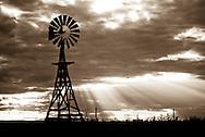 Traditional american water pumping windmill just below Bear Mountain near Hawk Springs, Wyoming.