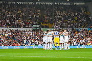 Leeds United players huddle during the EFL Cup match between Leeds United and Stoke City at Elland Road, Leeds, England on 27 August 2019.