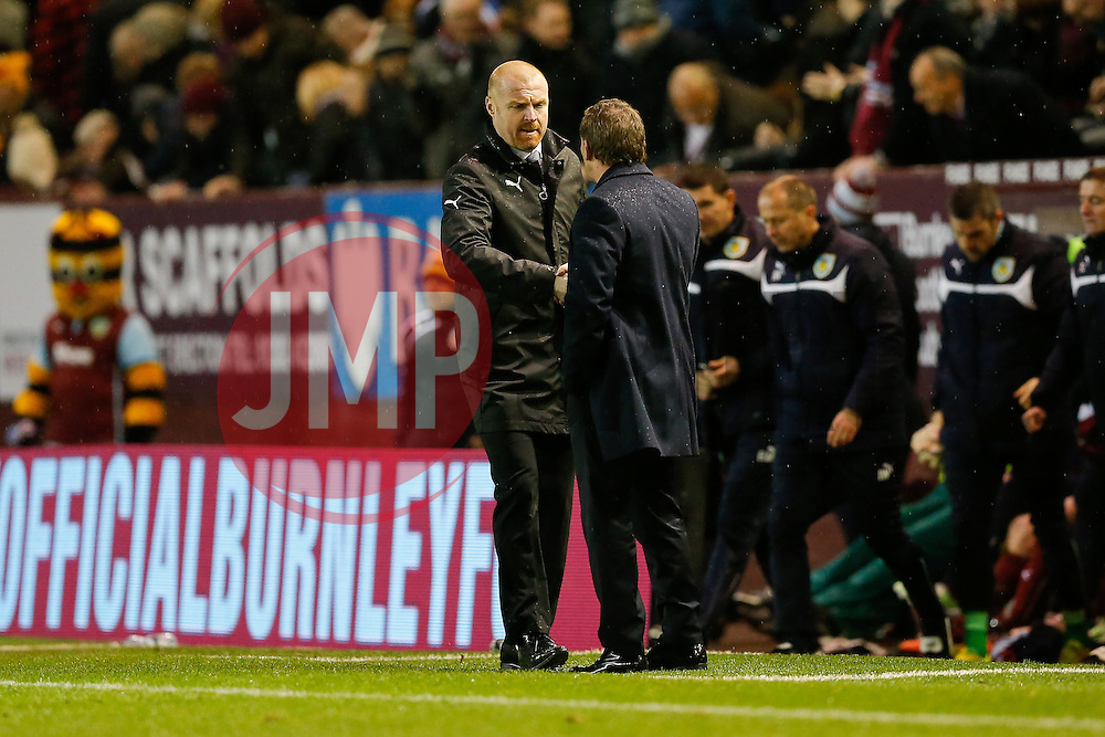 Burnley Manager Sean Dyche shakes hands with Liverpool Manager Brendan Rodgers at full time with Liverpool 0-1 winners - Photo mandatory by-line: Rogan Thomson/JMP - 07966 386802 - 26/12/2014 - SPORT - FOOTBALL - Burnley, England - Turf Moor Stadium - Burnley v Liverpool - Boxing Day Christmas Football - Barclays Premier League.