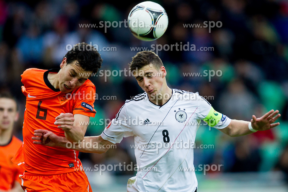 Thom Haye of Netherlands vs Leon Goretzka of Germany during the UEFA European Under-17 Championship Final match between Germany and Netherlands on May 16, 2012 in SRC Stozice, Ljubljana, Slovenia. Netherlands defeated Germany after penalty shots and became European Under-17 Champion 2012. (Photo by Vid Ponikvar / Sportida.com)