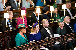 (front row) Sarah, Duchess of York , Princess Beatrice of York, Peter and Autumn Phillips and Mike Tindall take their seats ahead of the wedding of Princess Eugenie to Jack Brooksbank at St George's Chapel in Windsor Castle.