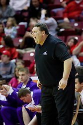 09 January 2010: Evansville coach Marty Simmons barks a command at his players on the floor. The Purple Aces of Evansville play the Redbirds of Illinois State on Doug Collins Court inside Redbird Arena at Normal Illinois.