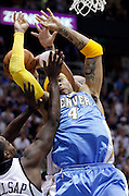 Denver Nuggets forward Kenyon Martin (4) is fouled by Utah Jazz forward Paul Millsap, left, and Carlos Boozer, back, during the first half of Game 4 of the NBA Western Conference first-round playoff series in Salt Lake City, Sunday, April 25, 2010. (AP Photo/Colin E Braley)
