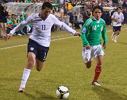 United States forward Brian Ching (11) runs past Mexico midfielder Israel Martinez (14).  The United States men's soccer team defeated the Mexican national team 2-0 in CONCACAF final group qualifying for the 2010 World Cup at Columbus Crew Stadium in Columbus, Ohio on February 11, 2009.