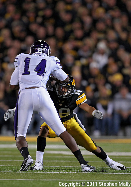 October 15, 2011: Iowa Hawkeyes cornerback Micah Hyde (18) tries to grab Northwestern Wildcats wide receiver Christian Jones (14) during the first half of the NCAA football game between the Northwestern Wildcats and the Iowa Hawkeyes at Kinnick Stadium in Iowa City, Iowa on Saturday, October 15, 2011. Iowa defeated Northwestern 41-31.