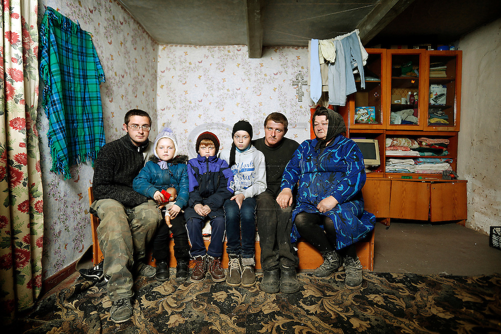 Liebiediev Sergii 24,  Daryna 7, Denys 9, Karyna 12, Viktor 23 pose for a family photo with their grandmother Zinaiida at her house. One week earlier at their house a fire erupted during the night. Their mother rescued the children and went back home to help her husband and mother but the ceiling went down and killed the three.<br /> Last Summer Daryna went to Spain and next vacations Karyna and Denys will go to Spain or to Portugal for the first time.