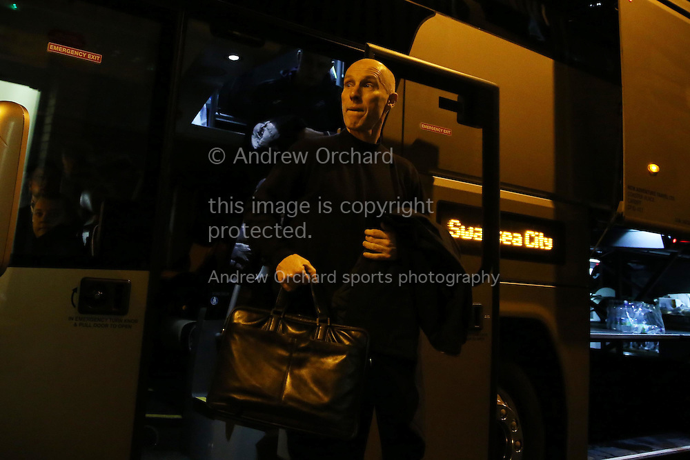 Bob Bradley , the Swansea city manager carrying his bag as he arrives in the team bus. Premier league match, West Bromwich Albion v Swansea city at the Hawthorns stadium in West Bromwich, Midlands on Wednesday 14th December 2016. pic by Andrew Orchard, Andrew Orchard sports photography.