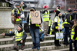 "© Licensed to London News Pictures . 05/01/2019. Manchester, UK. A man holds a placard against knife crime, "" mental illness jihad "" , Saudi funded shills , Brexit  betrayal and Jeremy Corbyn , in Piccadilly Gardens . A Yellow Vest demonstration takes place in St Peter's Square in central Manchester . The protest was organised via YouTube account "" Tommy Robinson News "" and was called in the wake of stabbings at Manchester Victoria Train Station on New Year's Eve . Protesters chanted in favour of Brexit , against police and press and carried pro-Trump and EDL clothing and placards . Photo credit : Joel Goodman/LNP"