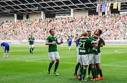 Players of Olimpija celebrate after Nik Kapun #23 of NK Olimpija Ljubljana scoring first goal for Olimpija during Preseason friendly football match between NK Olimpija Ljubljana and Chelsea FC (ENG), on July 27, 2014 in SRC Stozice, Ljubljana, Slovenia. Photo by Vid Ponikvar / Sportida.com