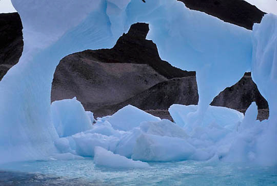 Antarctica, Melting and eroding iceberg off Antarctica Peninsula.