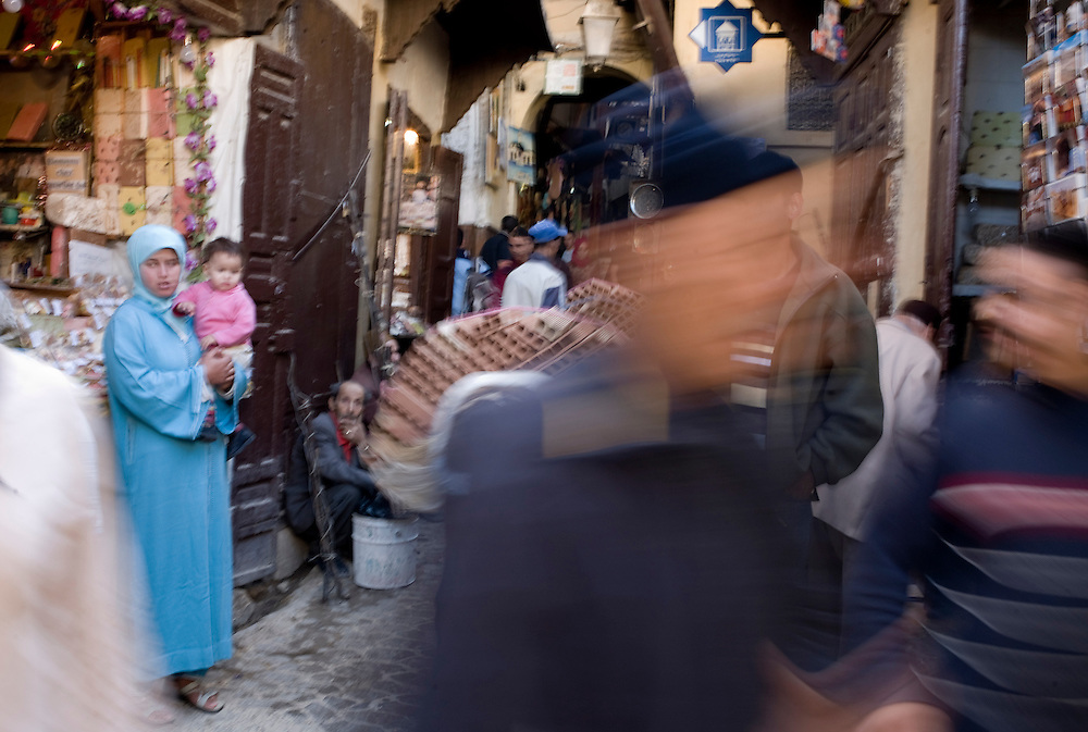 The narrow Fez medina streets and its souks are bustled with vendors, shops, people carrying goods and the daily life is overwhelmingly fast.