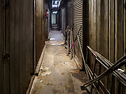 23 FEBRUARY 2018 - BANGKOK, THAILAND: An aisle of shuttered shops in Pratunam Market. Pratunam Market was one of the largest clothing markets in Bangkok. New airconditioned markets, like Platinum and Palladium malls opened nearby, siphoning away customers. Now there are only a handful of merchants left in the market and Bangkok city officials have plans to shut the market and redevelop the land.     PHOTO BY JACK KURTZ