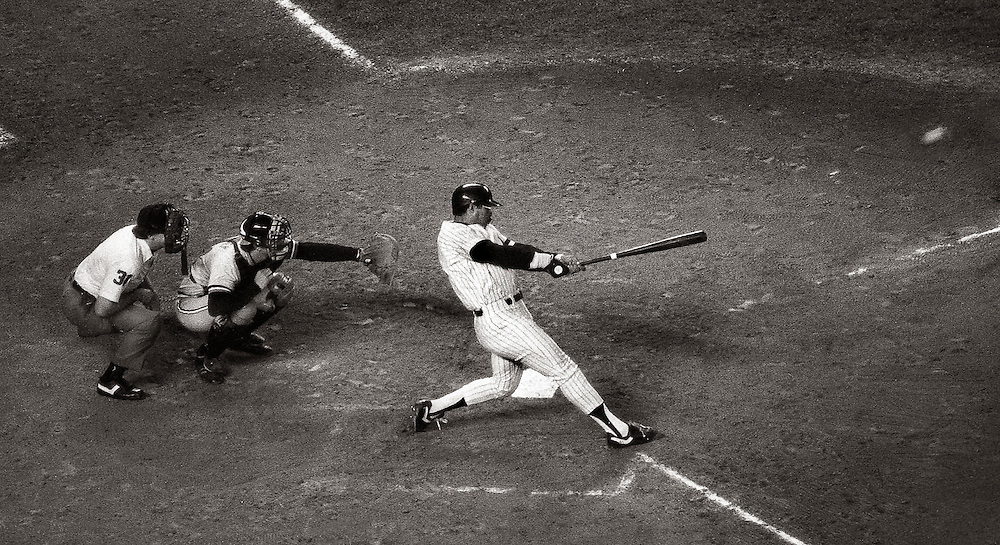 Former Yankee great Reggie Jackson's last regular season home run against the hated Baltimore Orioles flies off the bat on its way to the right field bleachers at Yankee Stadium. Had to shoot every swing he took that night, and finally got lucky. I believe it was his third at bat of the night. Shot with a 400mm fixed lens with Tri-x black and white. Most of the digital crowd today is probably not very familiar with this film, or with Reggie. It's a grainy film and has a much different appearance from digital.