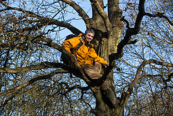 Harefield, UK. 18 January, 2020. Earth protector Freeman celebrates in the tree in Colne Valley wildlife protection camp in which he spent over two days and a night avoiding the clutches of enforcement agents acting for HS2 earlier in the week. Activists from Extinction Rebellion, Stop HS2 and Save the Colne Valley today reoccupied the camp from which all but two activists had been evicted by bailiffs the previous week on the second day of a three-day 'Stand for the Trees' protest in the Colne Valley timed to coincide with tree felling work by HS2. 108 ancient woodlands are set to be destroyed by the high-speed rail link.