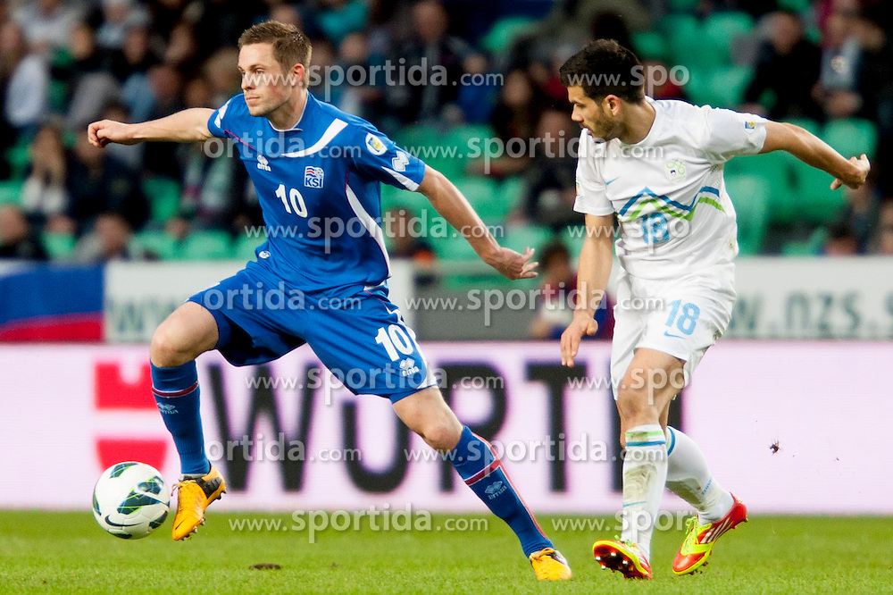 Gylfi Thor Sigurdsson #10 of Iceland and Aleksandar Radosavljevic #18 of Slovenia during football match between National teams of Slovenia and Iceland in Group E of FIFA World Cup 2014 Qualification on October 12, 2012 in SRC Stozice, Ljubljana, Slovenia. (Photo By Urban Urbanc / Sportida)