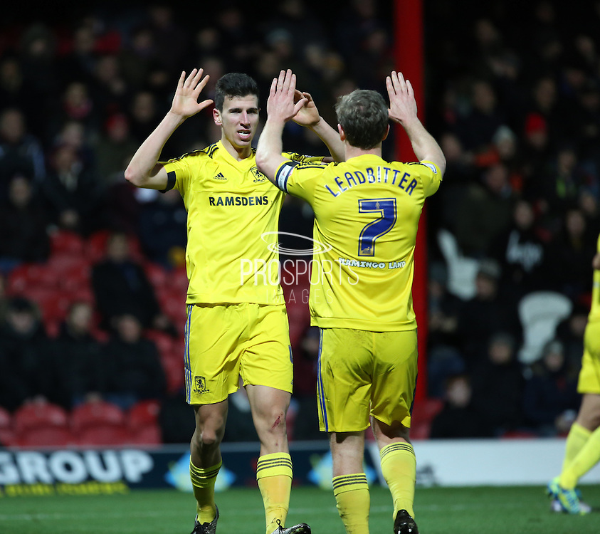 Middlesbrough defender Daniel Ayala celebrating with captain Middlesbrough midfielder Grant Leadbitter during the Sky Bet Championship match between Brentford and Middlesbrough at Griffin Park, London, England on 12 January 2016. Photo by Matthew Redman.