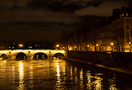The Pont Marie, the Il St Louis and lights reflected on the Seine at night. Paris, France, Europe