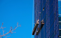CANADA ALBERTA CALGARY 9MAY07 - High altitude window cleaners at work in downtown Calgary, a boomtown due to the drastic expansion of energy production largely driven by aggressive exploitation of oil sands reserves in northern Alberta...jre/Photo by Jiri Rezac / WWF-UK..© Jiri Rezac 2007..Contact: +44 (0) 7050 110 417.Mobile: +44 (0) 7801 337 683.Office: +44 (0) 20 8968 9635..Email: jiri@jirirezac.com.Web: www.jirirezac.com..© All images Jiri Rezac 2007 - All rights reserved.