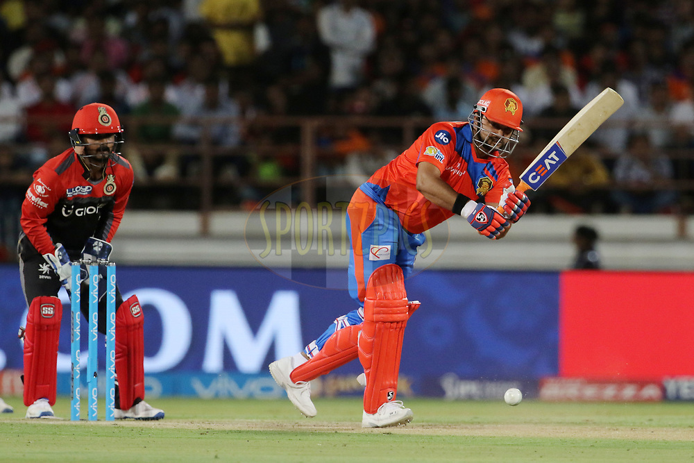 Gujarat Lions captain Suresh Raina plays a shot during match 20 of the Vivo 2017 Indian Premier League between the Gujarat Lions and the Royal Challengers Bangalore  held at the Saurashtra Cricket Association Stadium in Rajkot, India on the 18th April 2017<br /> <br /> Photo by Vipin Pawar - Sportzpics - IPL