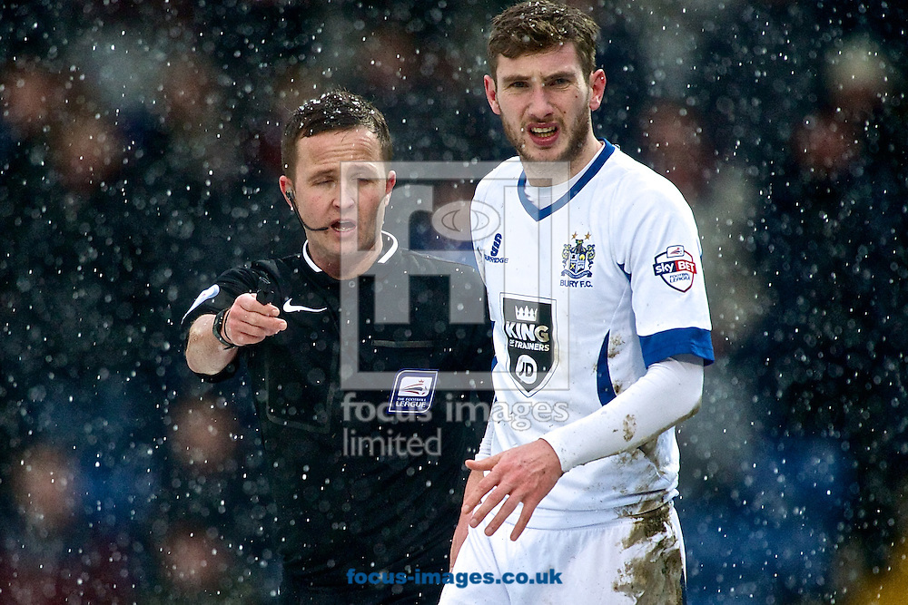 The referee leads Danny Mayor of Bury after he is injured scoring their first goal to make it Bury 1 Wycombe Wanderers 0 during the Sky Bet League 2 match at Gigg Lane, Bury<br /> Picture by Ian Wadkins/Focus Images Ltd +44 7877 568959<br /> 17/01/2015