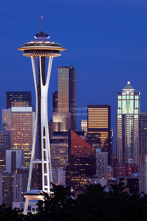 Space Needle with red white and blue stars and stripes paint with Seattle Washington skyline in back<br />
