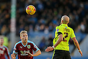 Burnley midfielder Scott Arfield  & Brighton defender Bruno Saltor  during the Sky Bet Championship match between Burnley and Brighton and Hove Albion at Turf Moor, Burnley, England on 22 November 2015. Photo by Simon Davies.