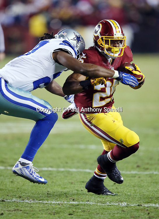 Washington Redskins running back Chris Thompson (25) tries to elude a tackle attempt as he runs with the ball after catching a fourth quarter pass during the 2015 week 13 regular season NFL football game against the Dallas Cowboys on Monday, Dec. 7, 2015 in Landover, Md. The Cowboys won the game 19-16. (©Paul Anthony Spinelli)