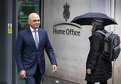 © Licensed to London News Pictures. 30/04/2018. London, UK. New Home Secretary Sajid Javid passes a member of staff under an umbrella as he walks out of the Home Office to pose for photographs. Amber Rudd resigned late last night. Photo credit: Peter Macdiarmid/LNP