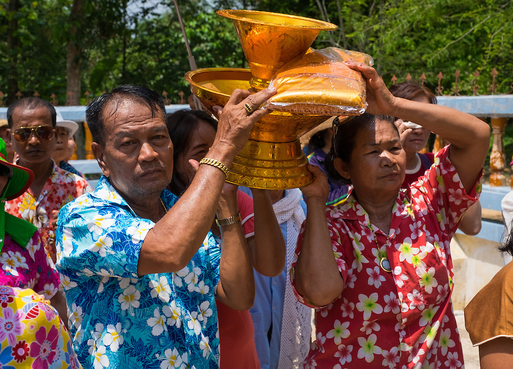 Participants carry gifts for the monks during Songkran in Rural Thailand 2016